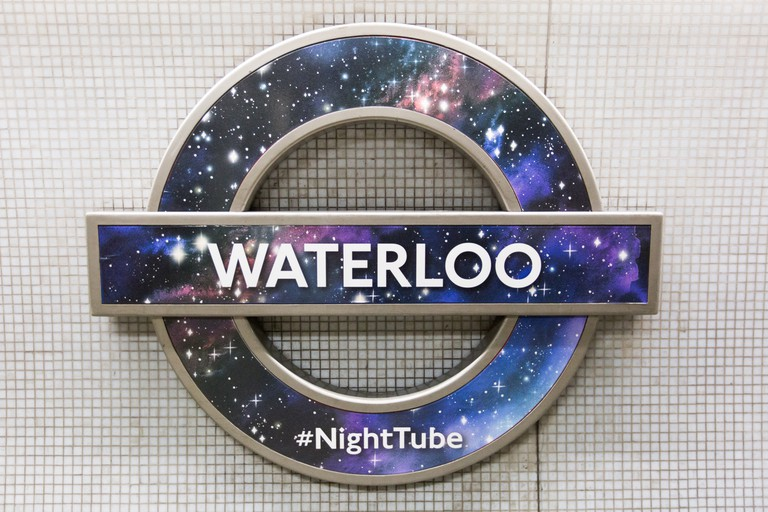 A London Underground Night Tube roundel is at Waterloo Station, London