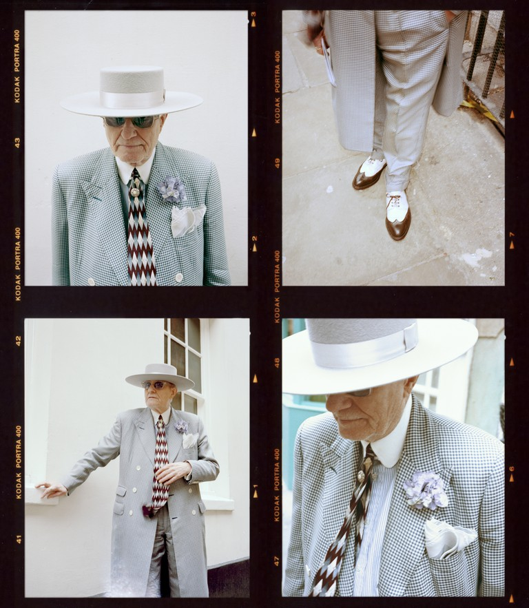 Today, Skeggs's signature look consists of longline, draped suiting in bold, checked patterns, bespoke headwear and customised details