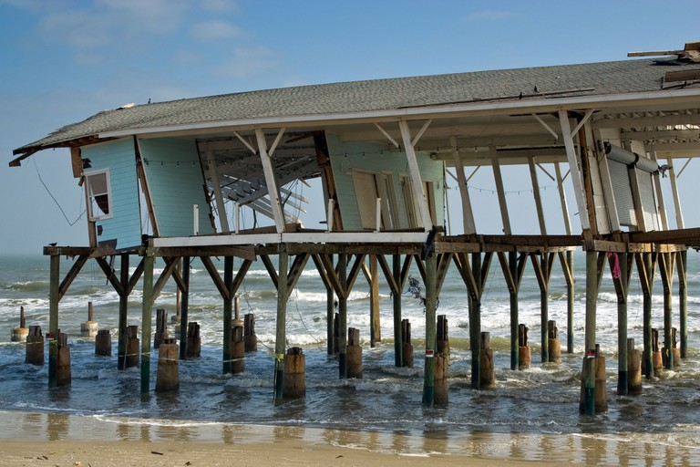Remains of souvenir shop destroyed by Hurricane Ike in 2008 on beach at Seawall Boulevard in Galveston Texas USA