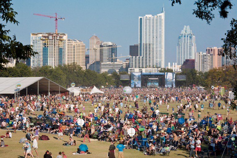 Thousands of music fans congregate on the lawn of Zilker Park during the Austin City Limits Music Festival