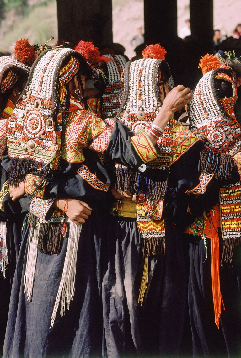 Pakistan, Chitral, Rumbur Valley, Kailash women dancing at annual harvest festival.