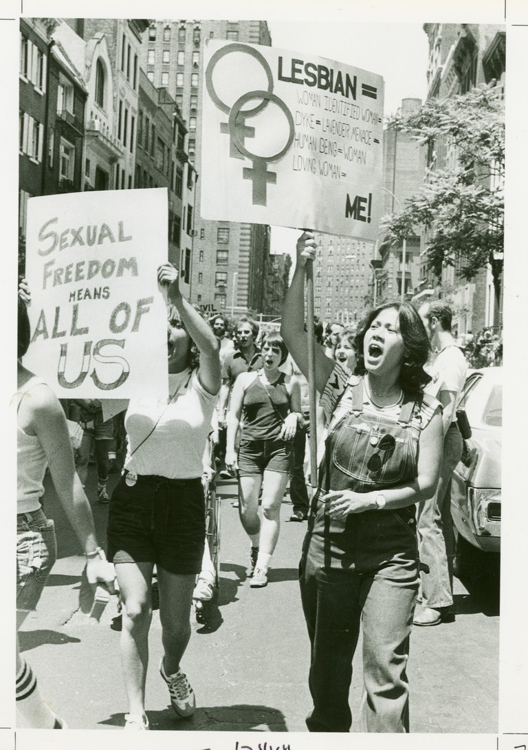 Women at demonstration with banners.