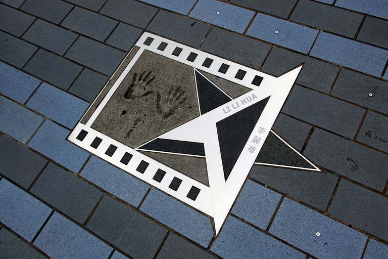 Star and handprints of Li Li Hua on avenue of the stars (walk of fame) on Victoria Harbour waterfront in Tsim Sha Tsui Hong Kong