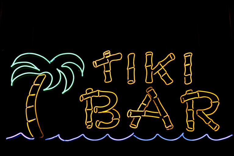 A neon sign for a Tiki Bar