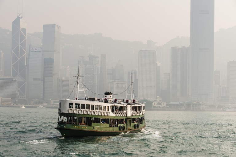 A harbour cruise on the Aqua Luna is very popular with tourists. At sunset the Hong Kong skyline is as spectacular as ever.