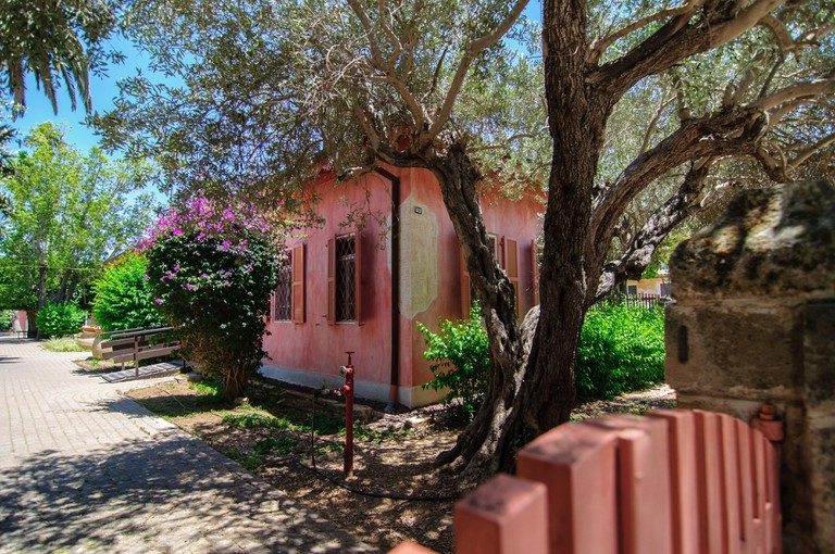 An old, pink, historical house in Zichron Yaakov, Israel.
