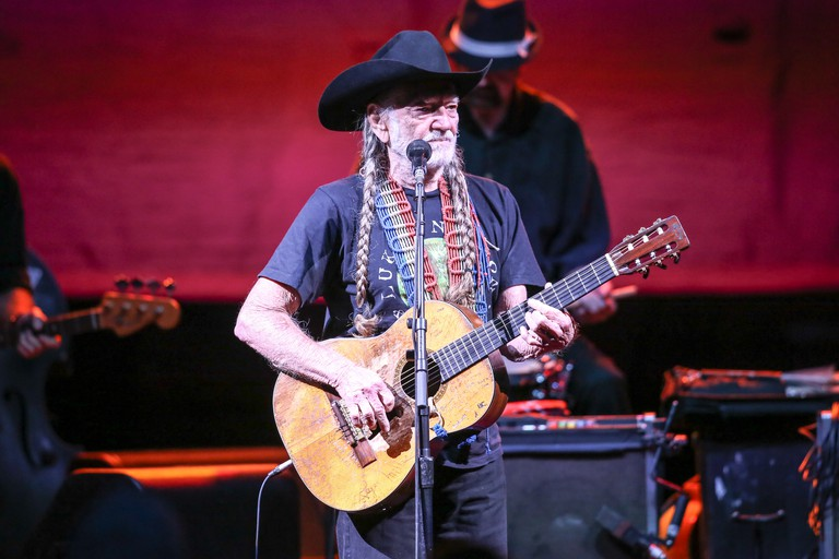 American country music singer-songwriter, as well as an author, poet, actor, and activist Willie Nelson on his 2014 Summer Tour.