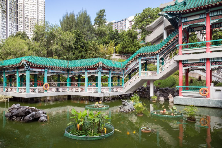 View of pond and Water Pavilion at the Sik Sik Yuen Wong Tai Sin Temple in Hong Kong, China.