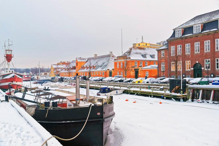 Nyhavn (New Harbor) in winter. It is waterfront, canal, entertainment district in Copenhagen, Denmark.