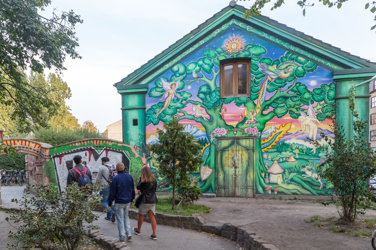 People entering the freetown district Christiania, Copenhagen, Denmark.