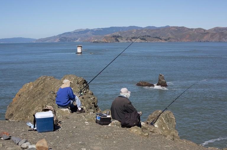 Two men fishing at Land's End in San Francisco.