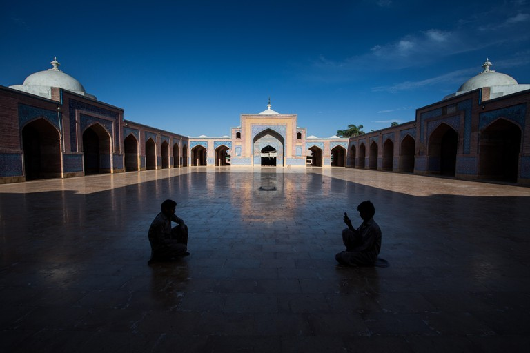 Boy takes a photo of his friend while on visit to Shah Jahan Mosque in Thatta Sindh, which was a gift to people of Thatta by Shah for their hospitality.