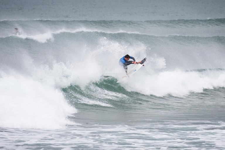 Geroid McDaid surfing in Bundoran, Ireland as part of anual Sea Sessions Surf & Music Festival.