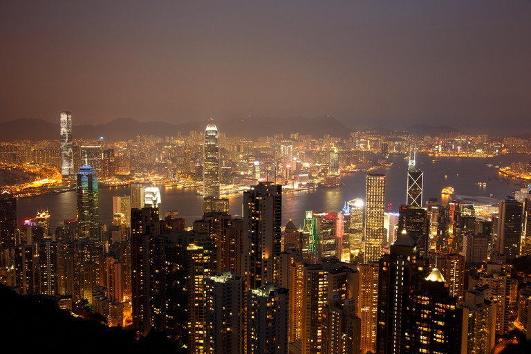 Illuminated skyline of Hong Kong at sunset