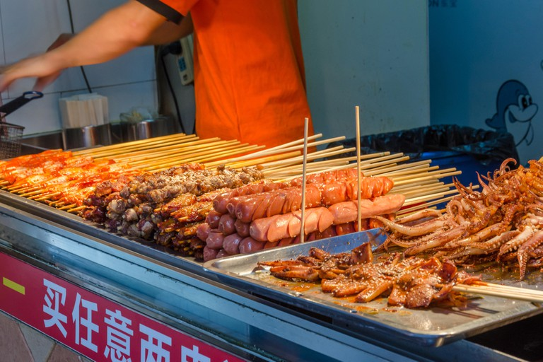 A stall selling street food in Tianzifang in Shanghai, China.