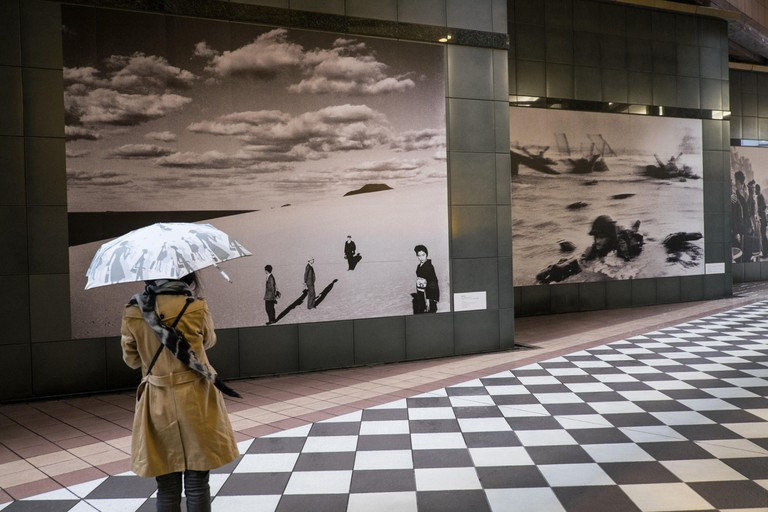 A person checks out an exhibit at the Tokyo Photographic Art Museum, Ebisu District, Tokyo
