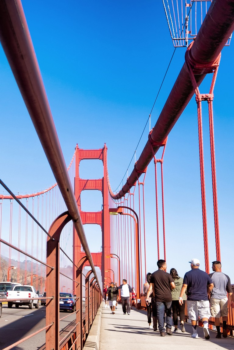 Walking across Golden Gate Bridge, San Francisco.