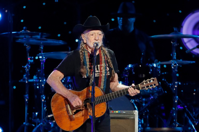 Willie Nelson performing in 2019 at Willie: Life & Songs Of An American Outlaw at Bridgestone Arena, in Nashville, Tennessee, USA.