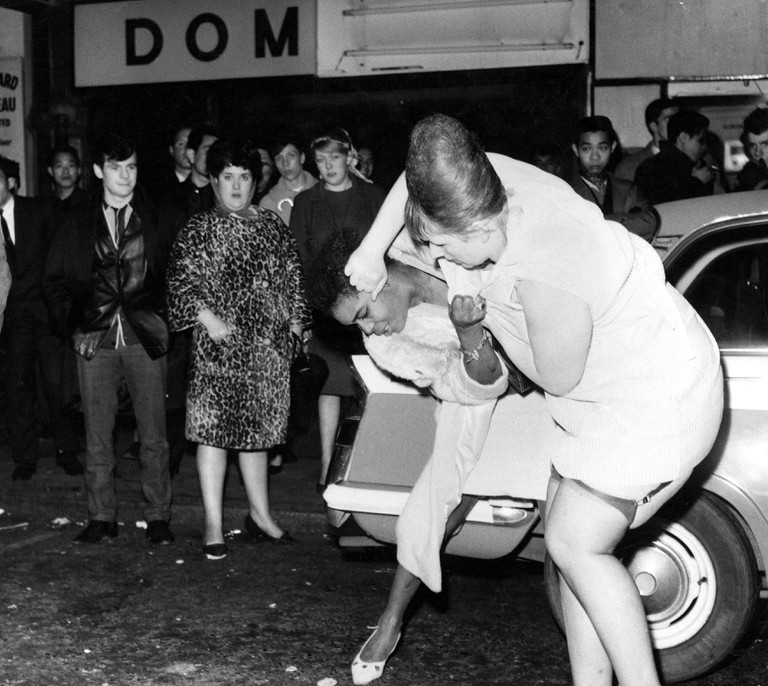 Two prostitutes fighting in a Soho street in London, Britain.