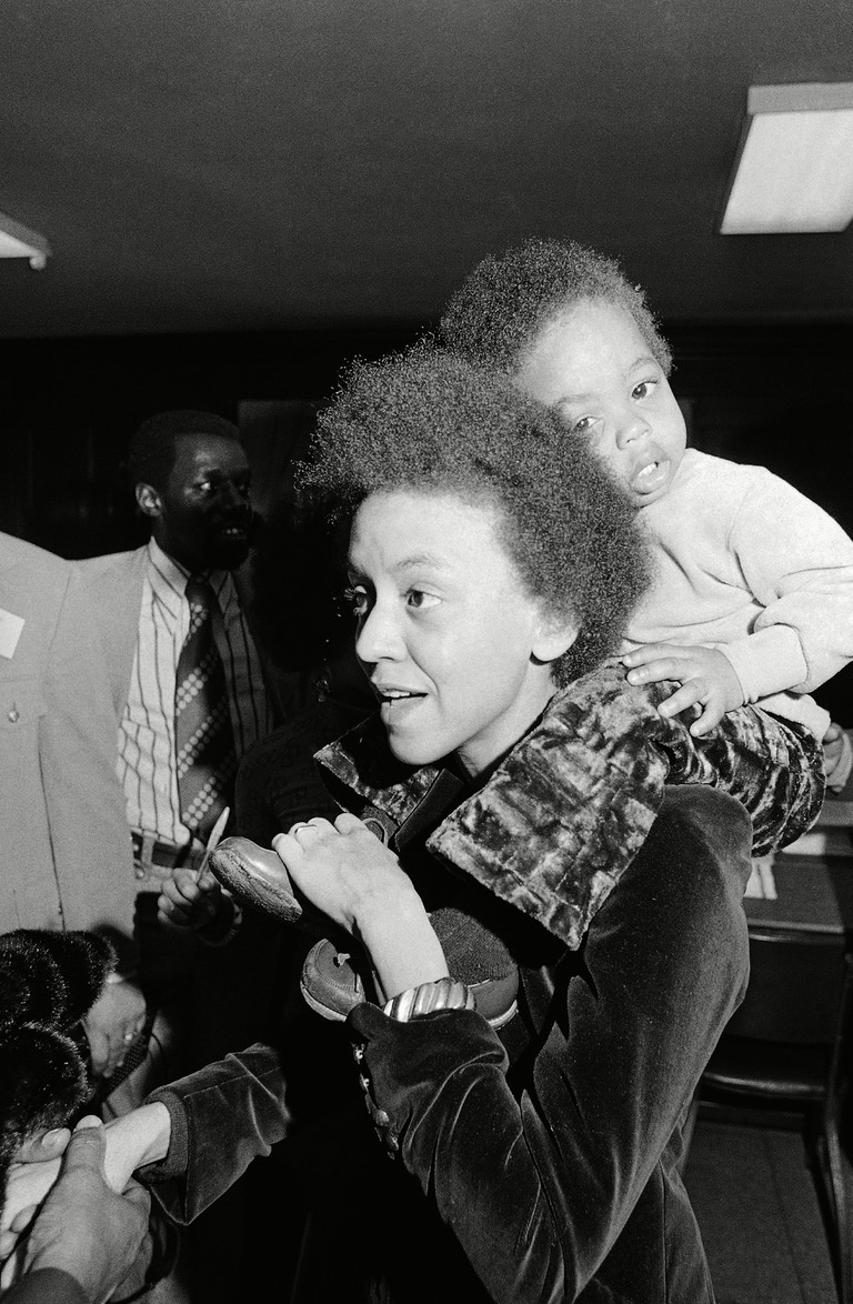 Poet Nikki Giovanni, with her son Thomas on her shoulder at the P.U.S.H. Soul Picnic at the 142nd St. Armory, New York, USA.