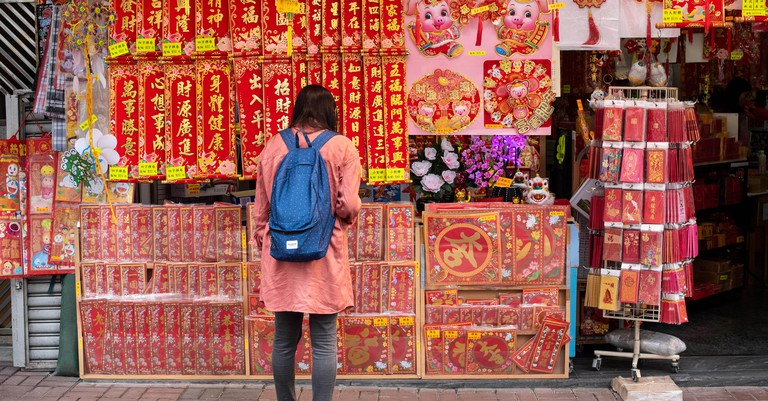 A woman seen shopping for decorative ornaments during the Lunar Chinese New Year.