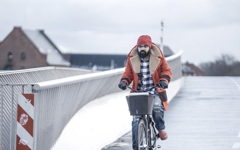 Cassam bicycling through Copenhagen. Still from Beyond Hollywood series, 2019, Denmark.
