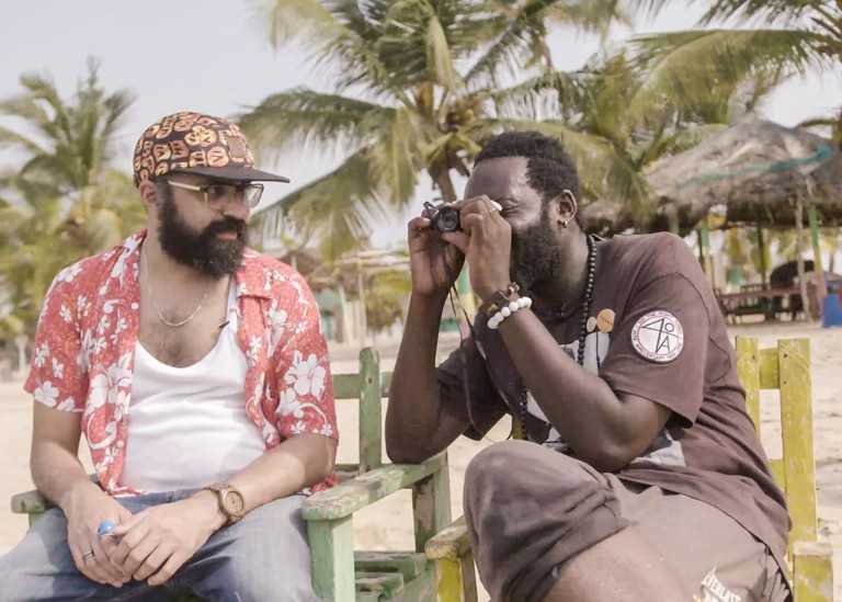 Cassam with a local filmmaker amidst making a film in 48 hrs. Still from Beyond Hollywood series. 2019, Ghana.