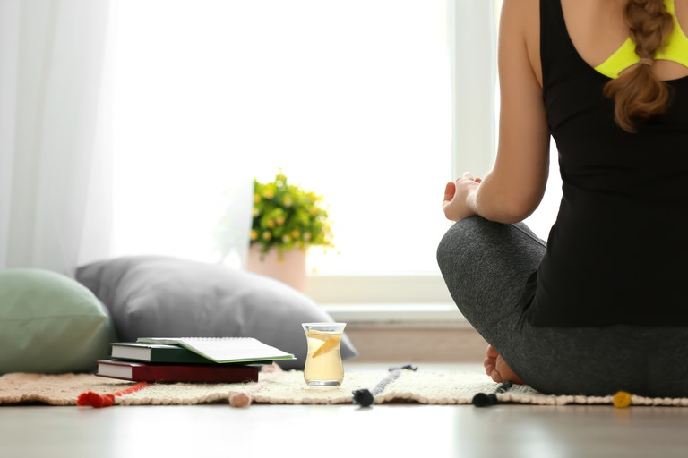 Practicing yoga.