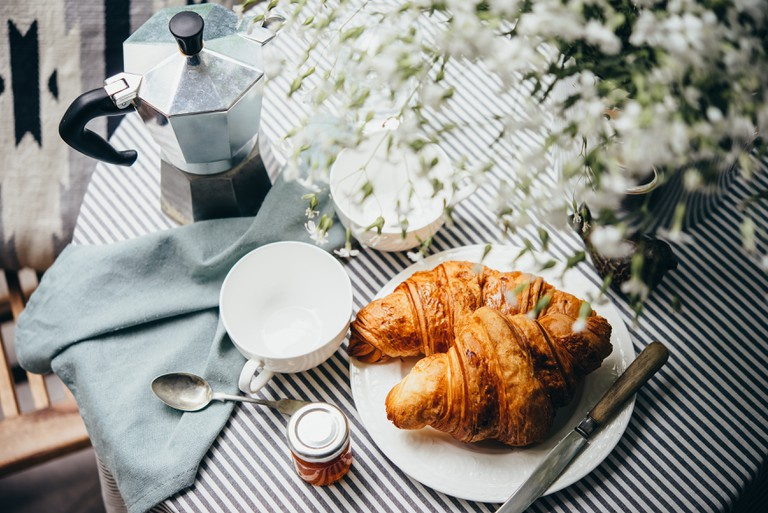 Breakfast with croissants, jam and coffee.