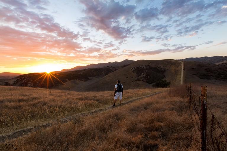 A hiker explores the Santa Monica Mountains, California