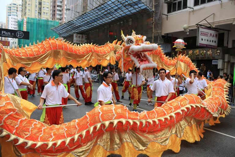 People dance the dragon in the Tin Hau birthday in Yuen Long. Tin Hau, Goddess of Sea in China.