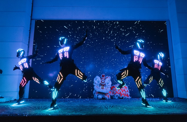Dancers perform on stage