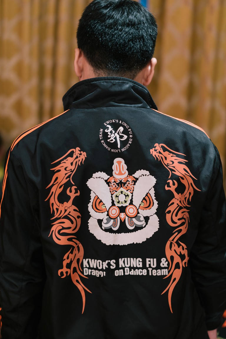 The logo of Kwok's Kung Fu and Dragon Lion Dance Team decorates a jacket