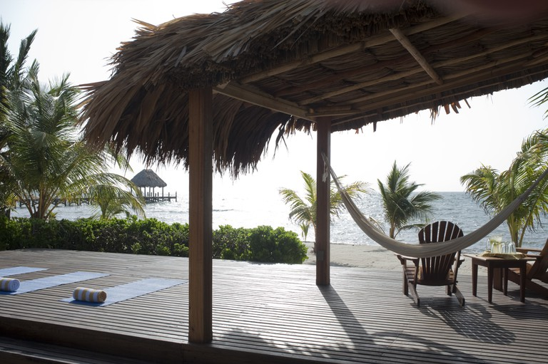 You can get away from it all, or at least from most of it, at The Turtle Inn in Belize