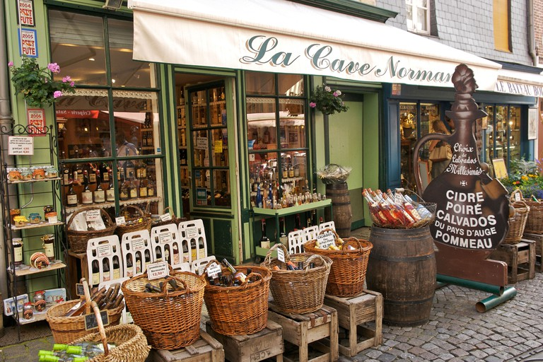 Local produce store selling drinks at Honfleur in Normandy France