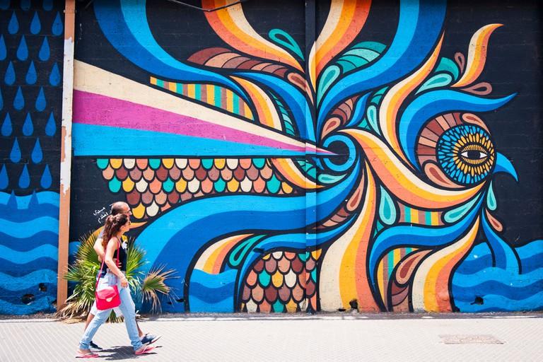 Israel Jaffa Yafo Old City graffiti street art mural quayside gallery outside wall fantasy design figure eyes by Beastman from Sydney