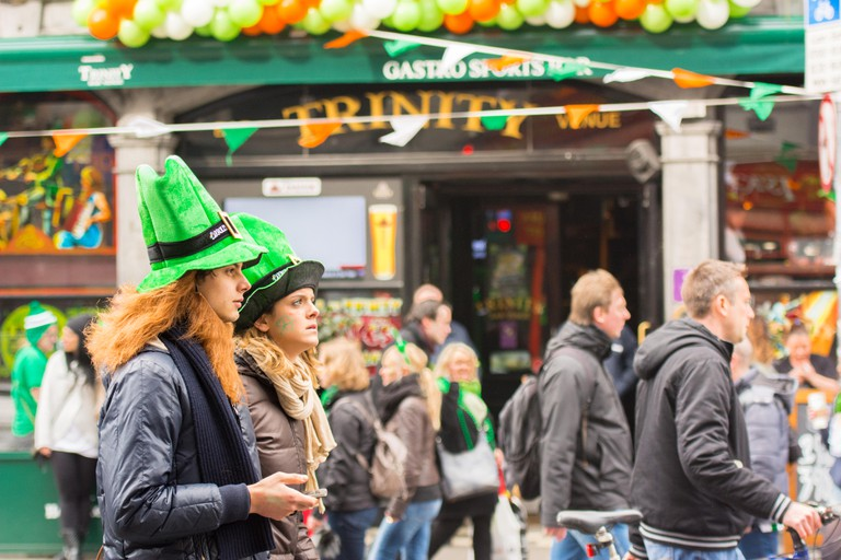 Festivalgoers on Dublin's Dame Street outside Trinity pub on St Patrick's Day 2015