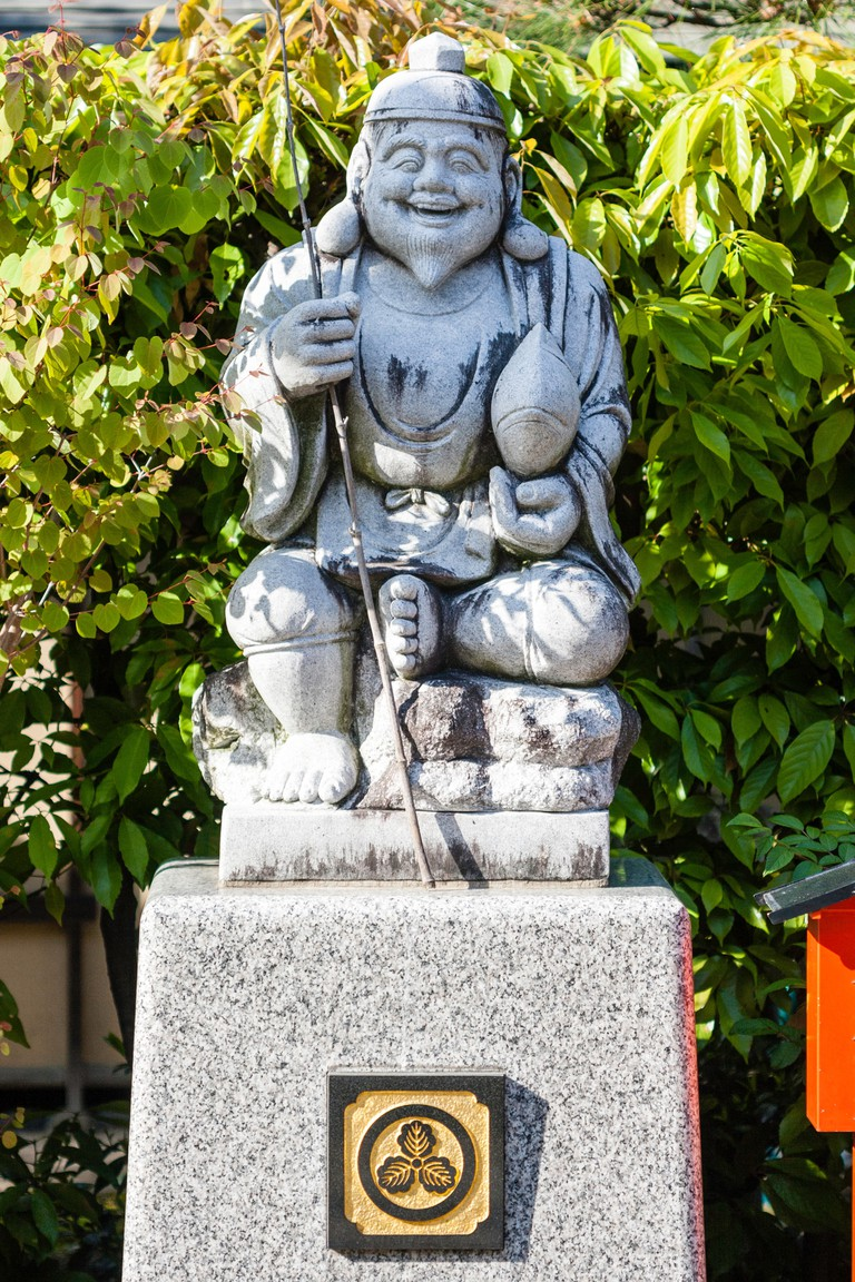 Statue of the Japanese God, Ebisu, aka Webisu, Hiruko god of fishermen and luck. One of the seven gods of good fortune.