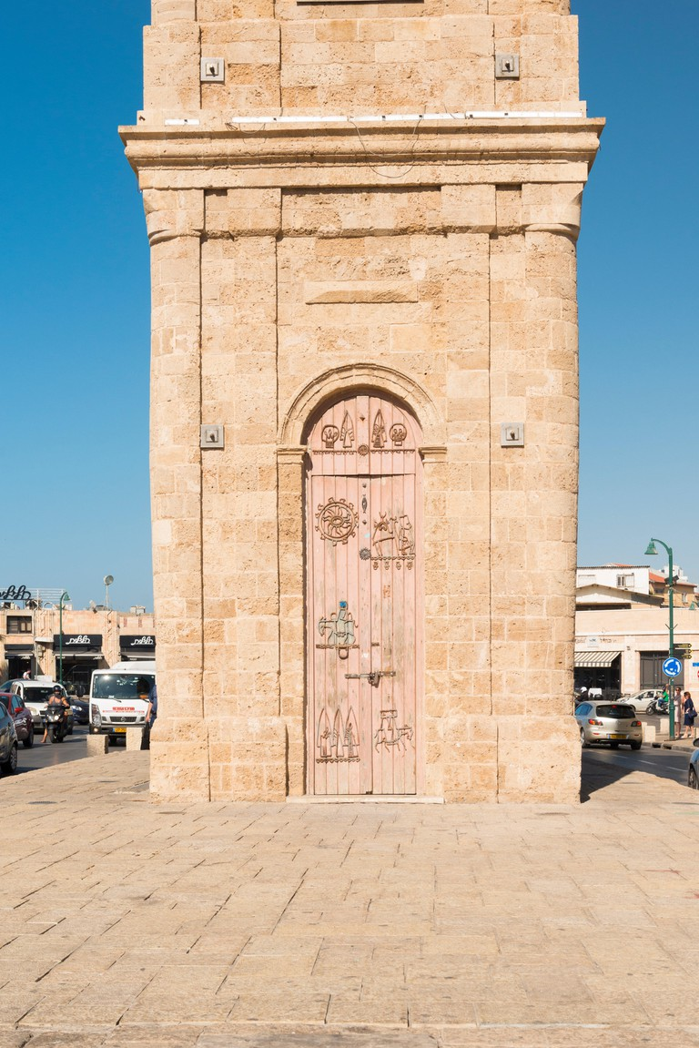 Jaffa Clock Tower built 1901 25th anniversary Turkish sultan ornate doors symbol modern Jaffa blue sky sunshine figures