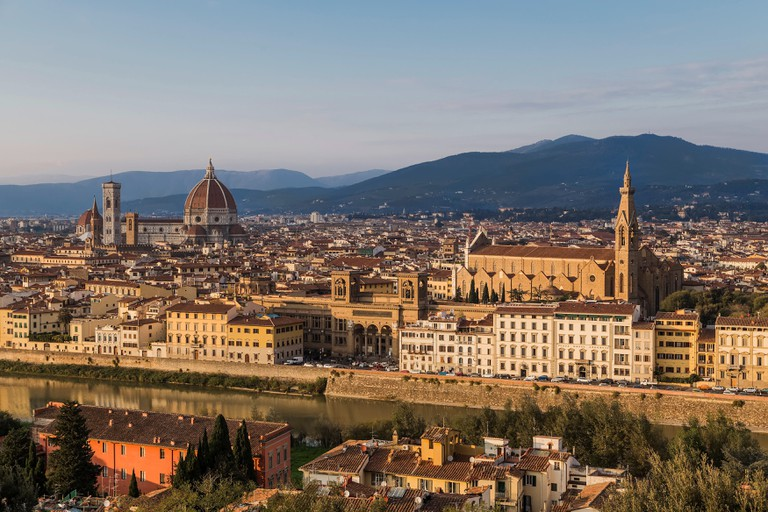 View of the Arno River, the Basilica of Santa - Croce and Santa - Maria - Del - Fiore in Florence. Italy.