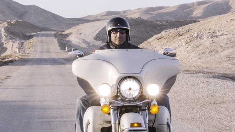 Wassim Razzouk on his motorcycle in Israel. Still from Culture Trip video. 2019.