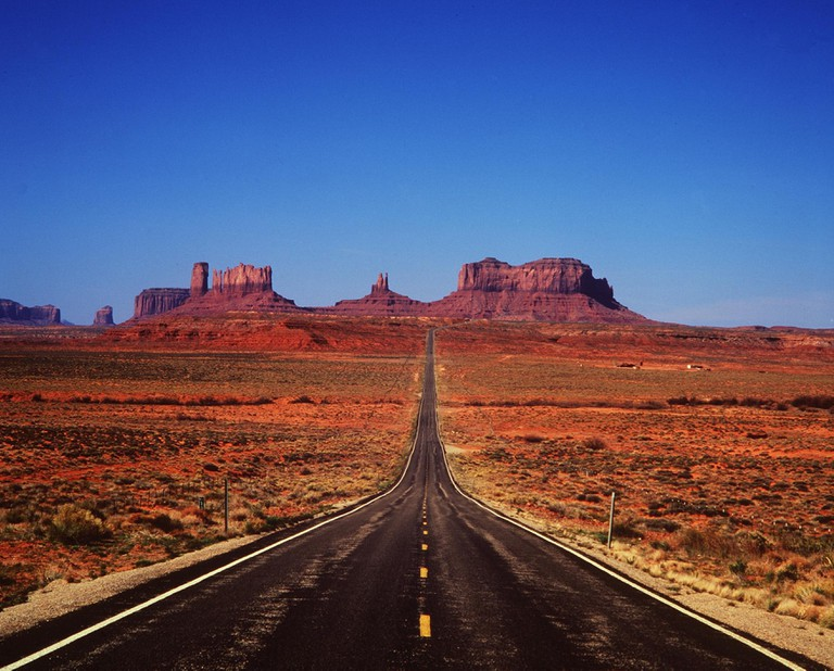 Road in the Arizona desert leading to Monument Valley.