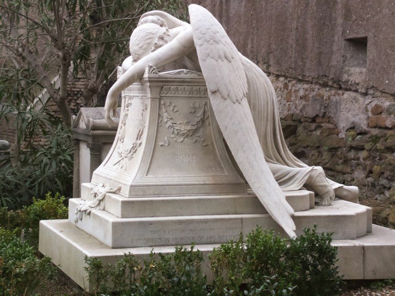 "The Angel of Grief sculpted by William Wetmore Story in memory of his wife placed in Cimitero Acattolico (""Non-Catholic Cemetery"") of Rome."