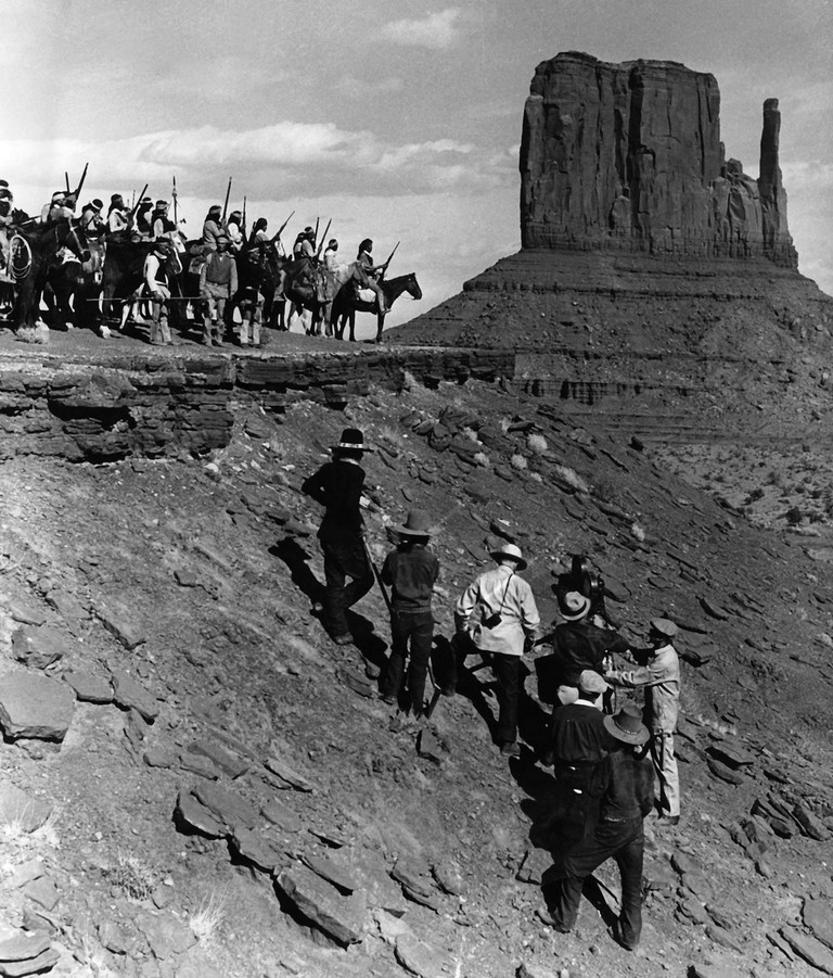 On the set of Stagecoach (1939), directed by John Ford. Monument Valley, USA.