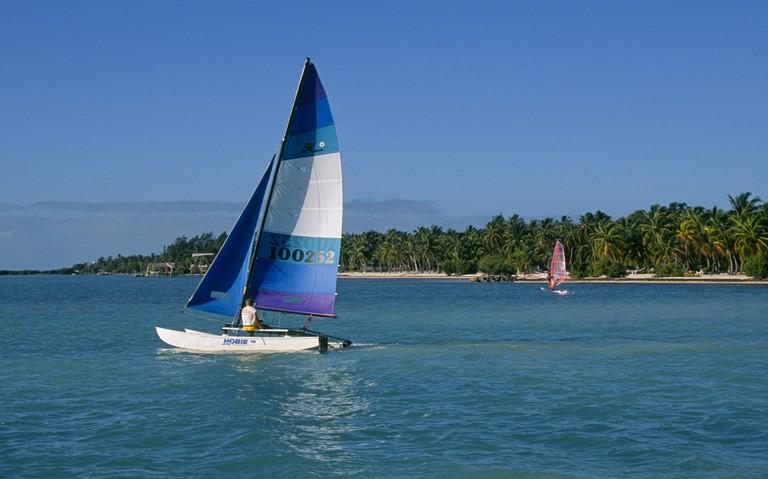 A small sail boat on the island of Islamorada in the Florida Keys.