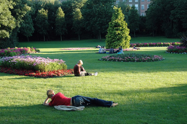 Students relax in Merrion Square Dublin Ireland