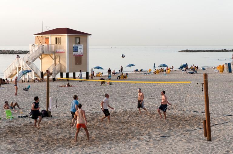 Men playing beach volleyball, Tel Aviv, Israel.