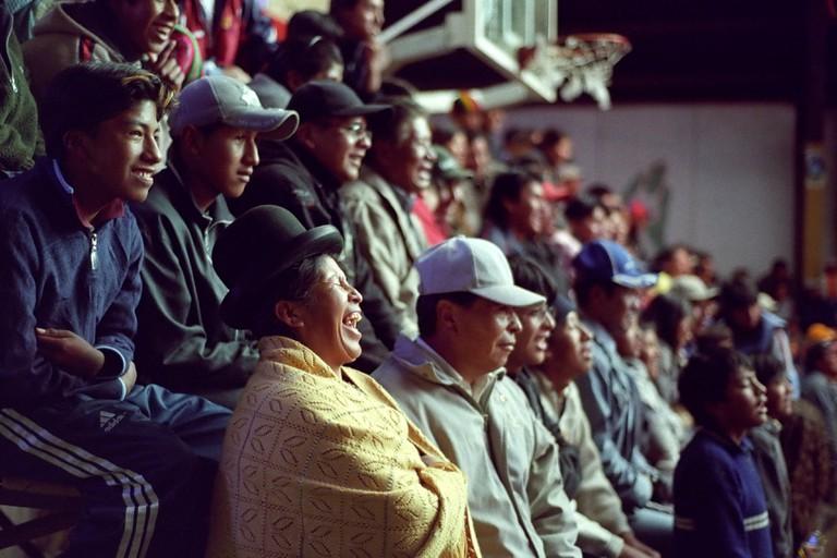 An indigenous woman reacts during Lucha Libre show, El Alto, La Paz