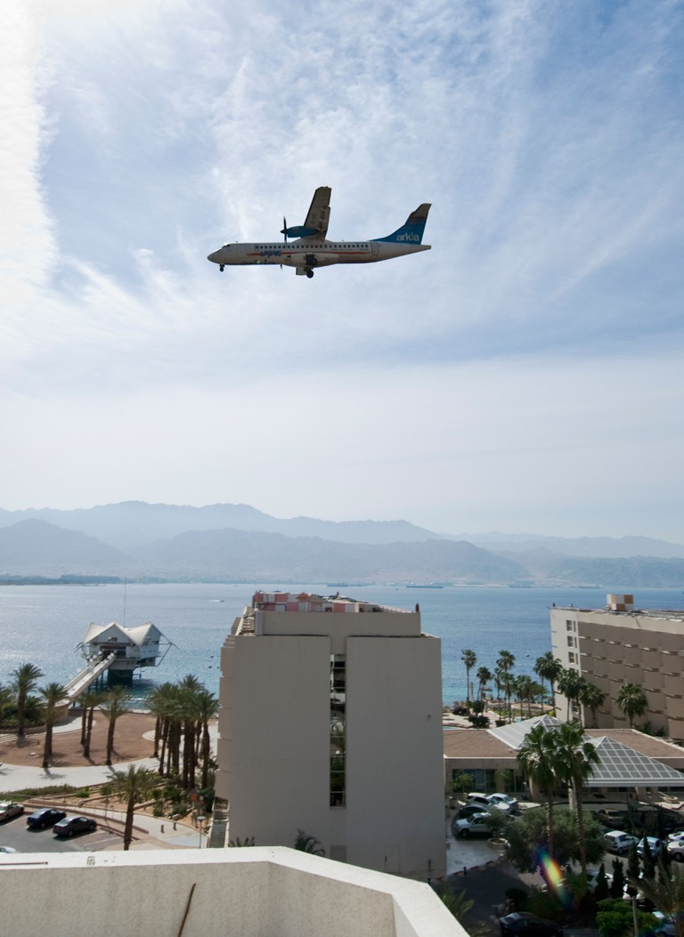 Airplane approaches landing over Israel.