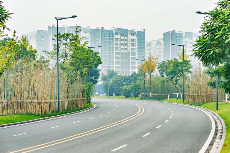Empty road at morning foggy time. Chengdu. China.